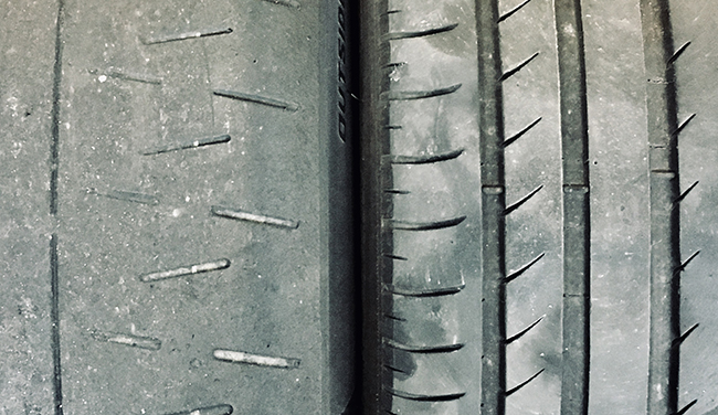 Comparing motorsport tire to high performance street tire.