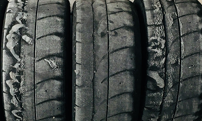 Motorsport tires exist to enhance vehicle performance, not to achieve maximum street mileage.