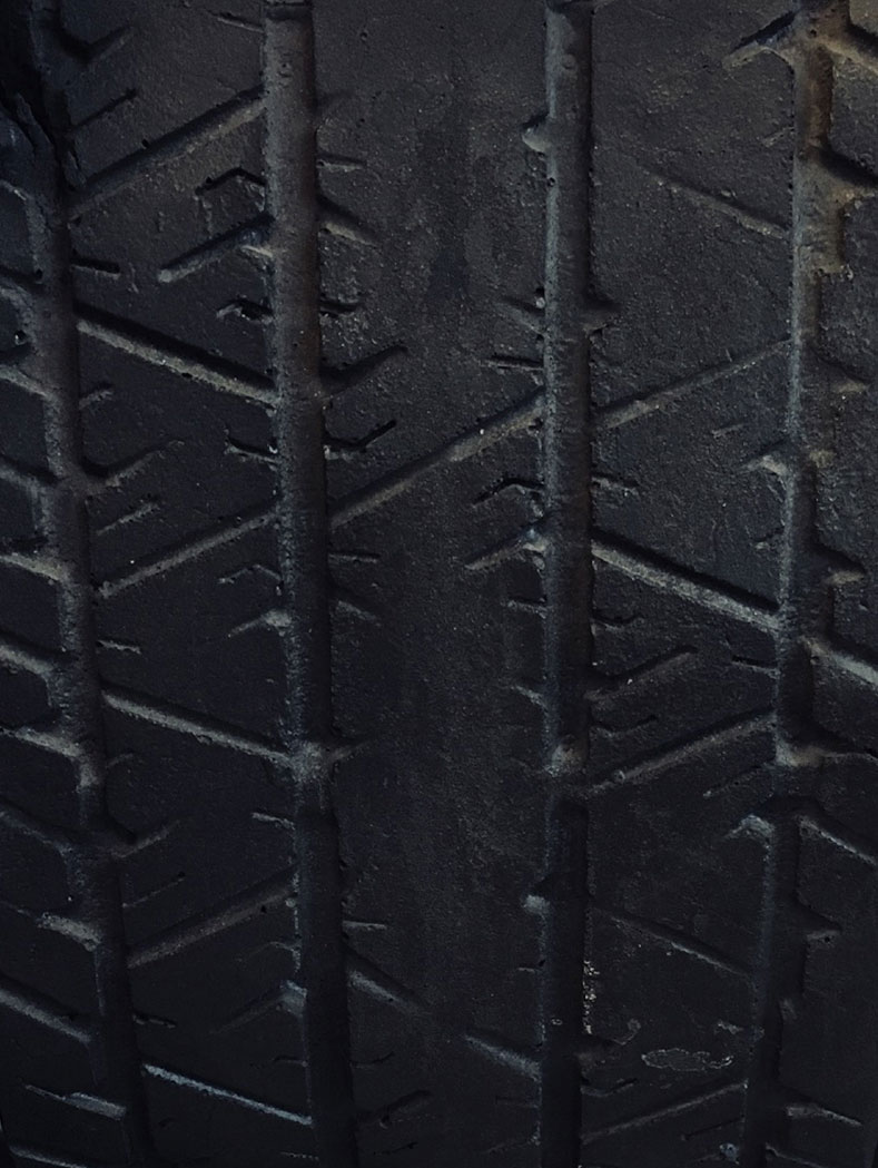Close-up of a tire showing its age